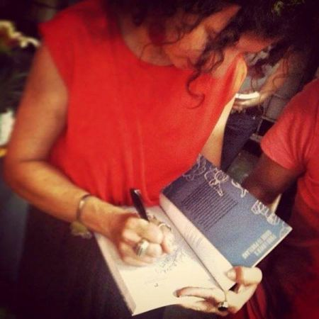 <p>Me learning how to write aka signing a copy of Food Lover&#8217;s Guide to Portland 2.0 at the book launch party.</p>