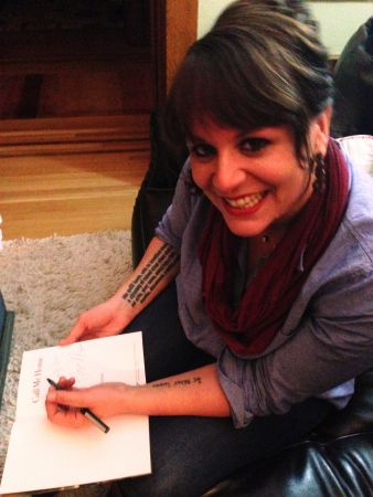 <p>Megan Kruse author of the debut novel <em>Call Me Home</em> signing books at the Hawthorne Books office.</p>