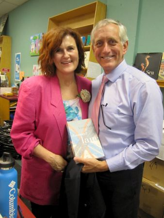 <p>Mayor Charlie Hales and author Karen Karbo at <cite>The Diamond Lane </cite>launch party at Broadway Books.</p>